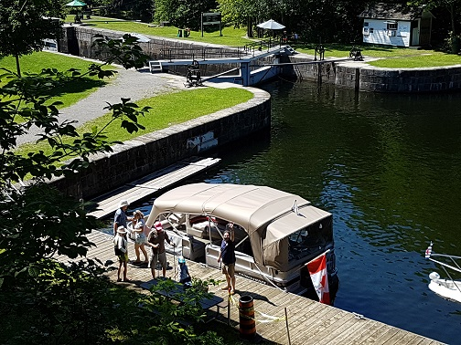 Guests aboard Rideau Tours boat disembarking at Jones Falls