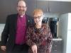 Gina cutting the cake with Bishop Poole